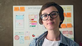 Portrait young UX designer smiling in creative agency office. Stock footage stock video footage