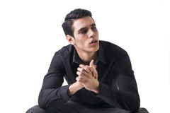 Portrait of a Young Vampire Man with Black Shirt Sitting on Floor Royalty Free Stock Photos