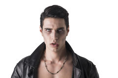 Portrait of a Young Vampire Man in an Open Black Leather Jacket, Royalty Free Stock Photography