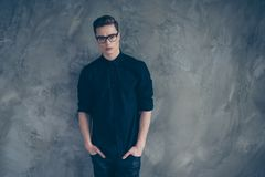 Portrait of young very handsome guy in black outfit and glasses stock images