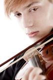 Portrait of a young violinist. Portrait of young man playing on violin Stock Photo