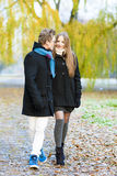 Portrait of young walking couple outside Royalty Free Stock Photos