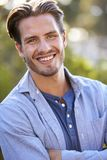 Portrait of young white man smiling outdoors Royalty Free Stock Photography