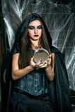 Portrait of a young witch. Halloween, horror Stock Images