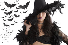 Portrait of the young witch posing with black hat Stock Images