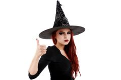 Portrait of young witch shows gesture Stock Images