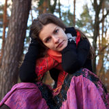Portrait of young woman. In autumn park Stock Photography