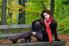 Portrait of young woman. In autumn park Royalty Free Stock Photo