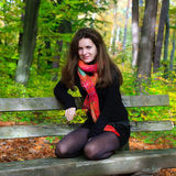 Portrait of young woman. In autumn park Stock Images