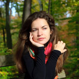 Portrait of young woman. In autumn park Stock Photos