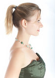 Portrait of the young woman. Young beautiful girl in celebratory clothes and with a necklace on a neck royalty free stock image