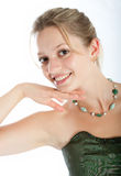 Portrait of the young woman. Young beautiful girl in celebratory clothes and with a necklace on a neck stock photo