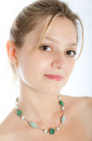 Portrait of the young woman. Young beautiful girl in necklace on a neck royalty free stock photo