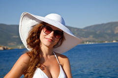 Portrait of young woman. Outdoor portrait of young woman in white hat Royalty Free Stock Photos