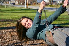 Portrait of a young woman. Young woman on the swings Stock Photography