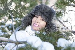 Portrait of young woman. In a snow park Stock Image