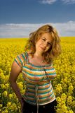 Portrait of a young woman. In rapeseed field Stock Image
