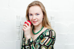 Portrait of the young woman. Portrait of the young pretty woman with apple Stock Photos