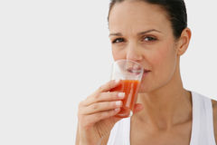 Portrait of a young woman. Drinking tomato juice Stock Photos
