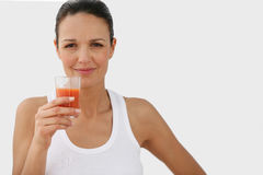 Portrait of a young woman. Drinking tomato juice Royalty Free Stock Photography