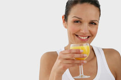 Portrait of a young woman. With a grass of orange juice Stock Photos