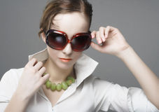 Portrait of young woman. With sunglasses Royalty Free Stock Image