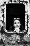 Portrait of a young woman in an abandoned wagon train. Black and white portrait of a young woman in an abandoned wagon train Stock Images