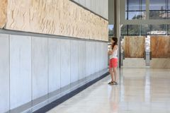 Brunette girl in Acropolis Museum. Portrait of young woman in Acropolis Museum Stock Photo