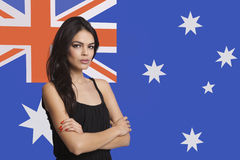 Portrait of young woman against Australian flag Stock Image