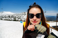 Portrait of young woman against a background of the winter sky Royalty Free Stock Images
