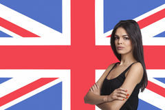 Portrait of young woman against British flag Royalty Free Stock Image