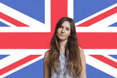 Portrait of young woman against British flag Royalty Free Stock Photography