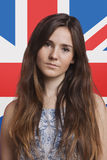 Portrait of young woman against British flag Royalty Free Stock Photos