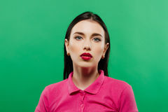 Portrait Of Young Woman against a green background.  Royalty Free Stock Photo