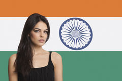 Portrait of young woman against Indian flag Stock Photo