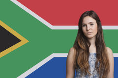 Portrait of young woman against South African flag royalty free stock images