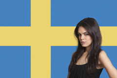 Portrait of young woman against Swedish flag Stock Images
