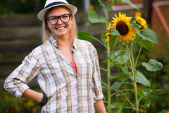 Portrait of young woman agronomist posing near sunflower Stock Photography