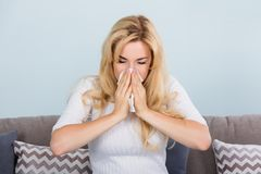 Woman Blowing Nose In Tissue Paper Stock Images