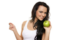 Portrait of a young woman with an apple Royalty Free Stock Photo