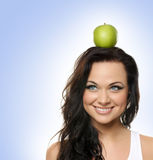 Portrait of a young woman with an apple Stock Photos