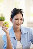 Portrait of young woman with apple Royalty Free Stock Image
