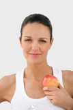 Portrait of a young woman with an apple. Portrait of a young caucasian woman holding an apple Royalty Free Stock Photo
