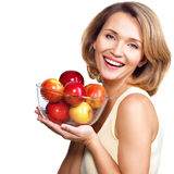 Portrait of a young woman with apples. Stock Images