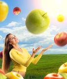 Portrait of young woman with apples, outdoors Royalty Free Stock Photo