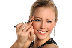 Portrait of Young Woman Applying Makeup Stock Image