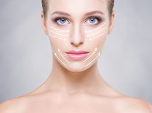 Portrait of a young woman with arrows on her face Stock Photos