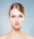 Portrait of a young woman with arrows on her face Royalty Free Stock Images