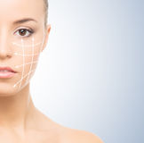 Portrait of a young woman with arrows on her face Royalty Free Stock Photos
