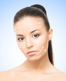 Portrait of a young woman with arrows on her face Royalty Free Stock Photo